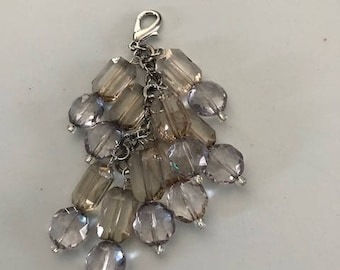 Clear grayish and gold colored beaded purse bling accessory