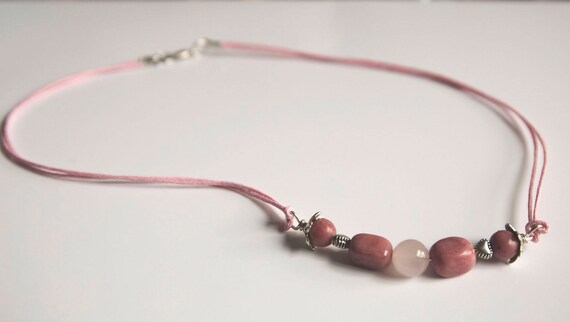 Rhodonite, Rose Quartz and Tibetan Silver Bracelet. Wire-wrapped with silver plated copper wire and strung on waxed cotton.