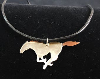 Sterling silver & copper horse pendant.