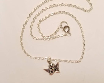 Sterling silver necklace with a Angel pendant.