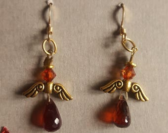 Garnet and gold angel earrings. January birthstone
