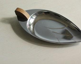 Leaf shaped chrome tray with a walnut handle