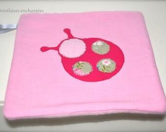 The enchanted fuchsia Ladybug tag blanket