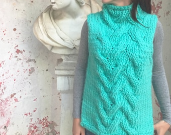 Giant knit vest, bright turquoise
