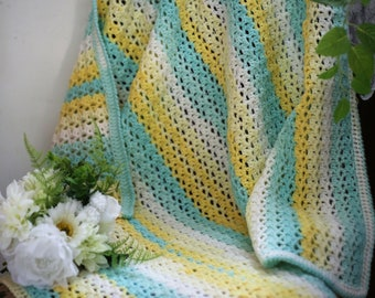 Crocheted baby cot or pram blanket in white, lemon, blue. Suitable for a Girl or Boy.