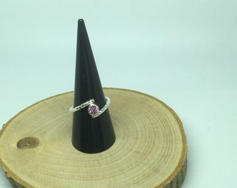 Sterling silver twist ring with pink gem