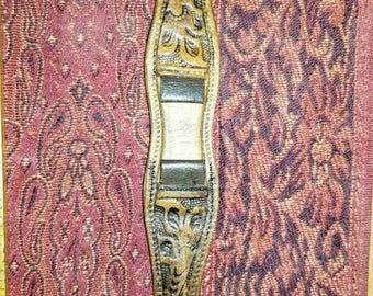 Vintage western tooled leather watch band with brass buckle.