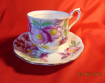 "One (1), 2 3/4"", Bone China, Tea Cup and Saucer, from Royal Albert, in the Flower of the Month (Older Hampton Design)N0. 6 Dog Rose Pattern."