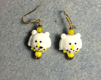 White and yellow lampwork owl bead dangle earrings adorned with yellow Czech glass beads.