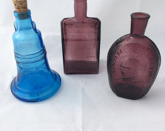 Three Wheaton reproduction glass bottles