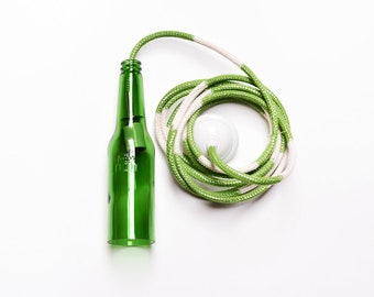 hand knitted cable with a green Plzeňský Prazdroj beer bottle