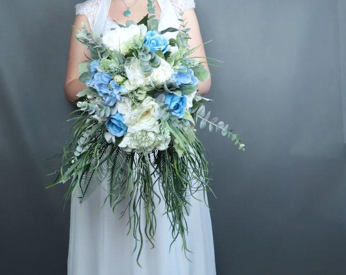 Cascading greenery pastel blue white ivory flowers bridal bouquet Best quality dusty miller roses hydrangea eucalyptus southwestern wedding