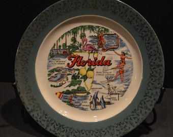 Florida Souvenir Plate with a Green Rim and Gold Overlay from the 1950s made by Homer Laughlin