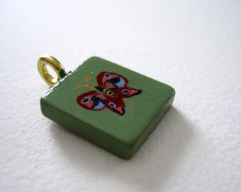 Butterfly hand painted Scrabble Tile pendant w/ cord rainbow green