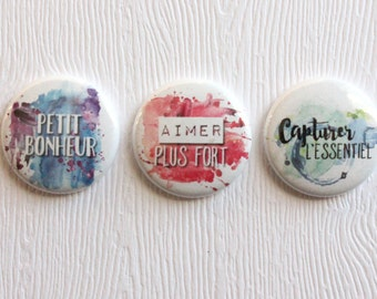 "3 badges 1 ""capture the essence"