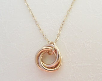 Cartier love pendant etsy gold love knot necklace trinity necklace gold trinity necklace 14k gold fill trinity aloadofball Choice Image