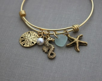 Sea life Bracelet gold plated stainless steel adjustable bangle bracelet with genuine sea glass, and Pearl, Starfish, Seahorse Sand dollar