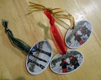 Oval Christmas tree decorations ,  2 designs Children Playing and/or Winter Scene