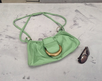 Vintage 1980s green leather handbag with large Brass Buckle and rings