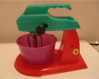 Vintage plastic toy friction mixer works