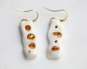 Vai. Porcelain and gold earrings, glazed. Porcelain jewelry. Ceramic jewellery