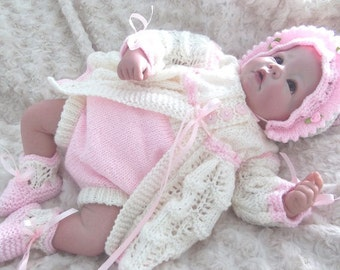 Beautiful knitting pattern to make this lovely babies outfit