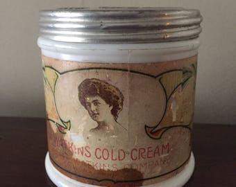 Antique cold cream jar, Watkins co.  1920.   Milk glass jar with original label and matching embossed lid.