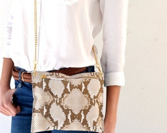 Leather beige purse with snake pattern