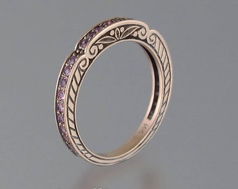 CARYATID wedding band in 14k rose gold with pink sapphires