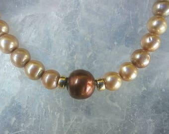 Genuine Pearl and Real Gold beaded necklace with gold clasp.