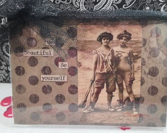 Vintage photo frame Be beautiful be yourself 2 girls by the sea