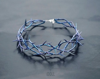 Crown of thorns on a head. Iridescent colour.