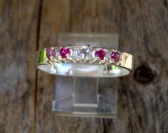 Ring - Natural rubies surround a little pink emerald in Custom Wedding or anniversary ring the silver is eco friendly recycled/reclaimed