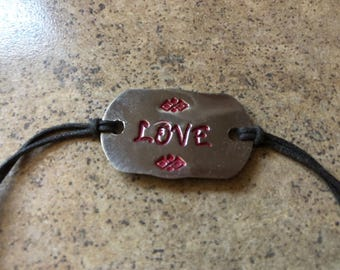 Love, hand-stamped Bracelet with waxed cotton cord. Lobster clasp closure.