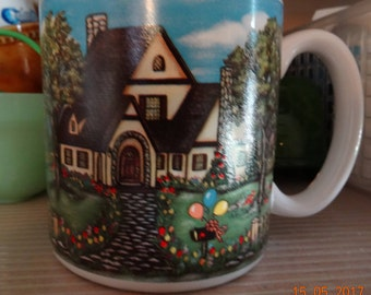 Bone china mug depicting cottage and garden with balloons