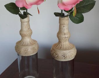 Vases with glass bottles.