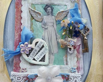 shabby cottage chic  collage with black and white photo and antique key millinery flowers angel wings pastels pink blue