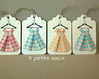 white paper, folding origami dresses 4 tags, vintage