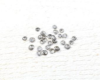 100 bead caps in silver colored metal caps