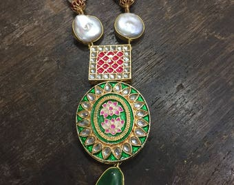 Beautiful pearl necklace with green and pink pendant