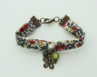 Liberty fabric bracelet, green beads, flower and metal clasp old gold.