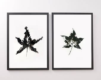 Painting with black and white leaf