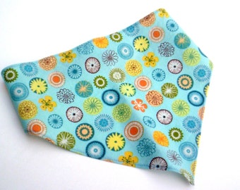 Blue Yellow And Orange Sprials On Girls Head Scarf