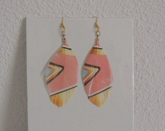 These earrings different colors of feathers.