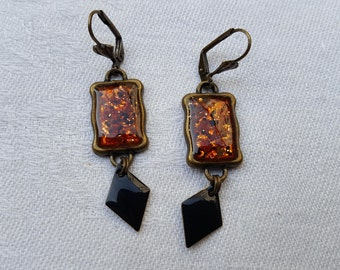 Black and copper earrings include resin, black enameled diamonds