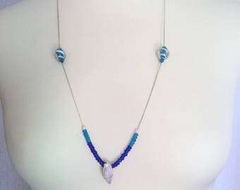 Silver necklace with blue pearls and shell