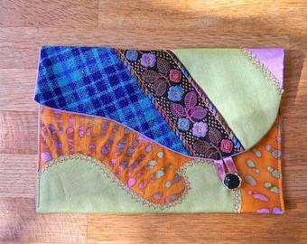 106 pocket flap, fabrics and multicolored braid.