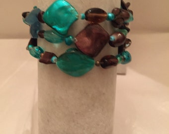 Size Small-Med Turquoise and Brown  Bracelets