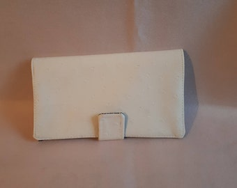 Fabric checkbook and white faux leather