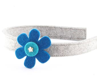 Handmade headband made of felt with flower decorated with a pearl